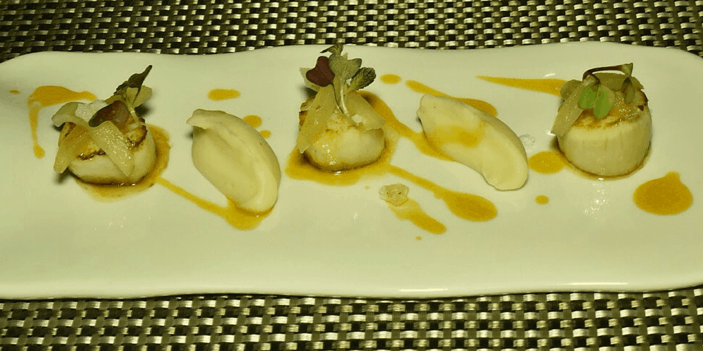 Pan seared scallops, puree of celeriac, acid apples, white truffle olí and passion fruit coulis