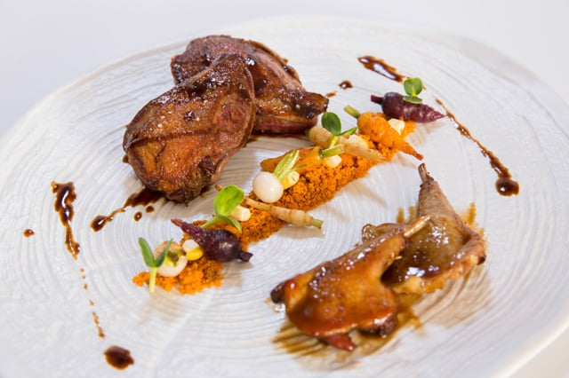 Pigeon on two cooking with armagnac sauce and mini vegetable garden