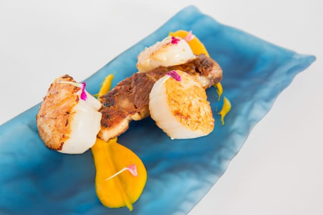 Grilled scallops with sweet potato puree and roasted pork jowls