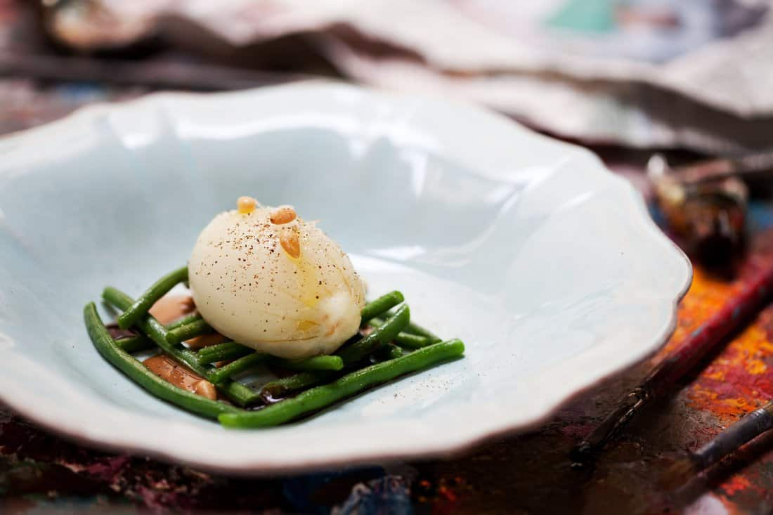 El Cercle Restaurant: Cod Brandada with sweet onion, black garlic, pine nuts and French green beans