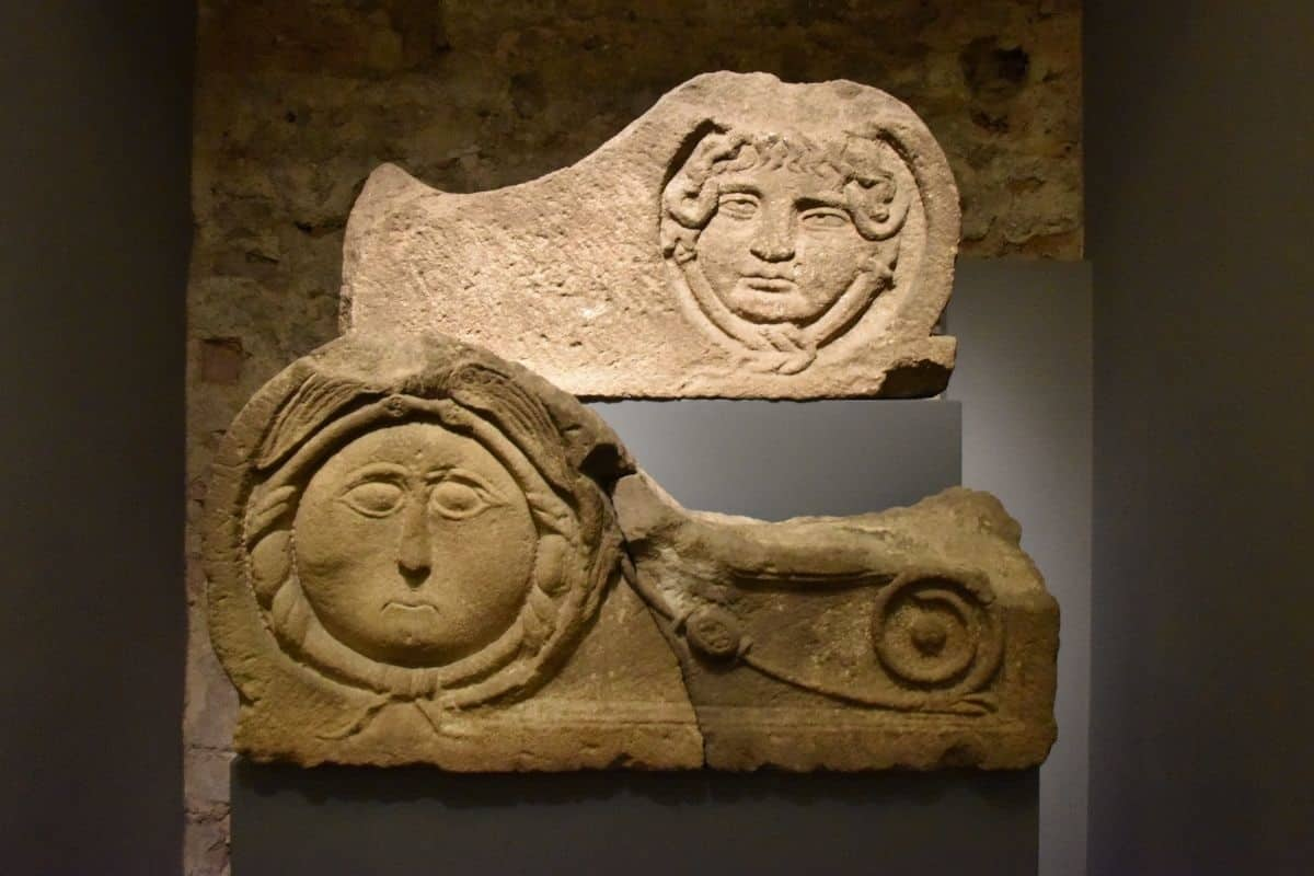 Acroteria of Montjuïc sandstone, 1st century A.D. Decorative elements representing Medusa's head that formed part of the crown of a funerary monument (MUHBA Plaça del Rei).