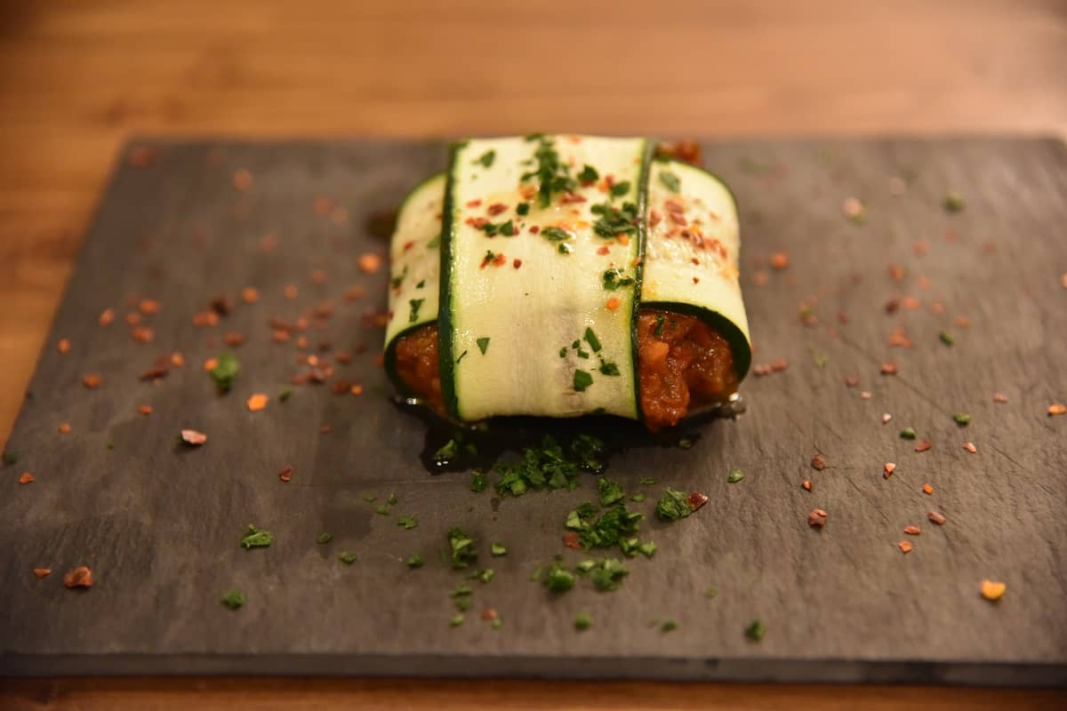Stuffed sanfaina wrapped with zucchini strips