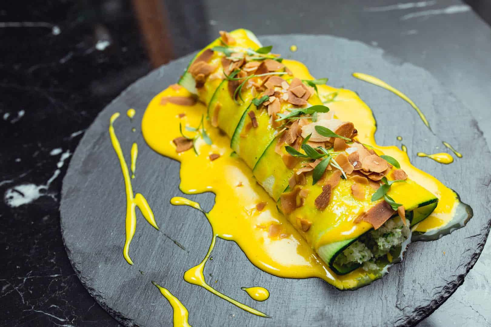 Zucchini cannelloni with cauliflower couscous, goat cheese & turmeric sauce